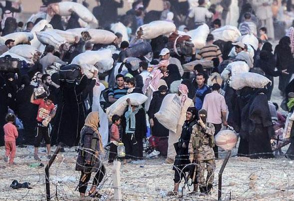 ИГИЛ загоняет людей обратно в Tal Abyad ?